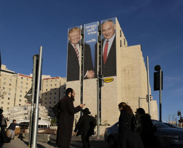 US President Trump and Israel PM Netanyahu on a campaign poster in Jerusalem. Photo: Getty Images