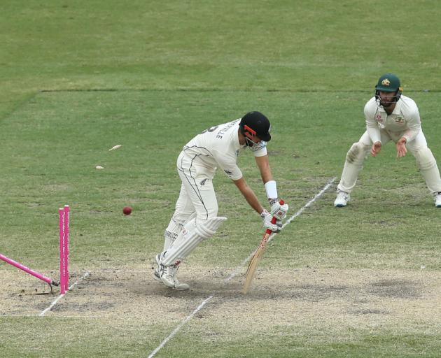 Will Somerville is bowled by Mitchell Starc on day four of the third Test in Sydney. Photo: Getty...