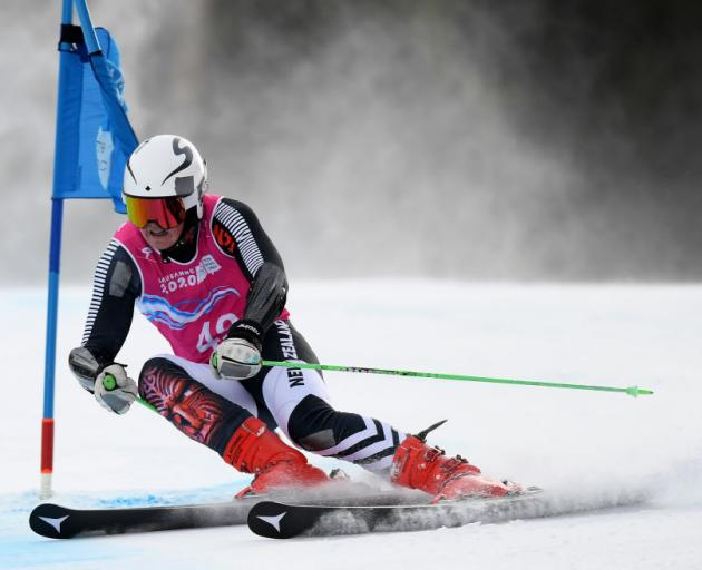 New Zealander Harrison Messenger competes in the first round of the men's giant slalom at the Winter Youth Olympics in Lausanne yesterday. Photo: Getty Images