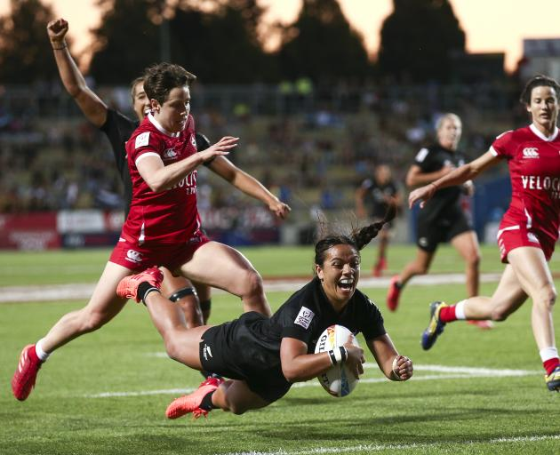 Stacey Fluhler of New Zealand scores a try during the Cup Final match between Canada and New...