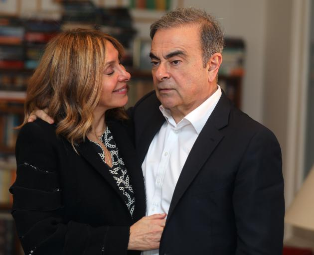 Former Nissan chairman Carlos Ghosn and his wife Carole Ghosn pose for a picture after an...