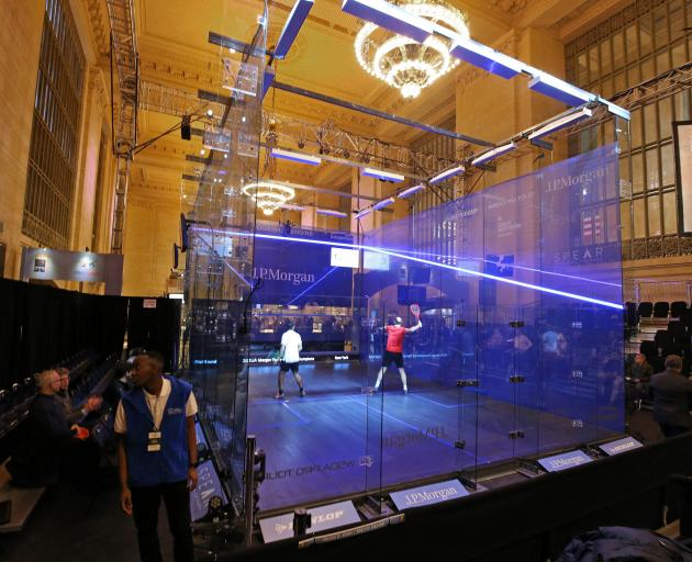 Players in action the first round of the Tournament of Champions squash event at Grand Central Station, New York yesterday. Photo: Tournament of Champions