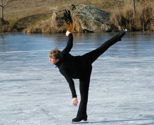 Testing out the ice at the Manorburn Dam. Photo: Supplied