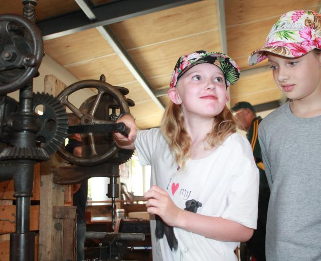 Getting some helpful advice from Mum and Dad, Ciara Donnelly tries out the vintage hand drill...