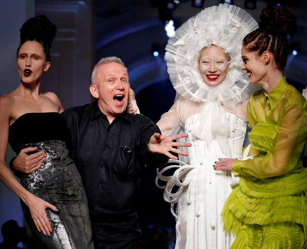 French designer Jean Paul Gaultier appears with models at the end of his Haute Couture Fall/Winter 2016/2017 collection in Paris. Photo: Reuters