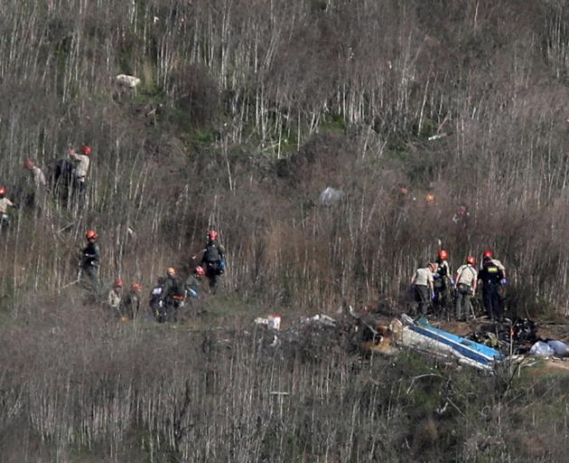 Investigators work at the scene of the helicopter crash which killed NBA star Kobe Bryant in Calabasas. Photo: Reuters