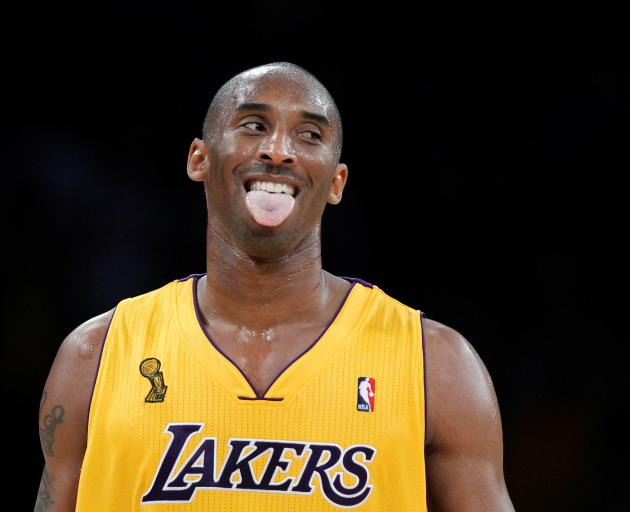 Los Angeles Lakers Kobe Bryant celebrates a shot by Steve Blake against the Houston Rockets...