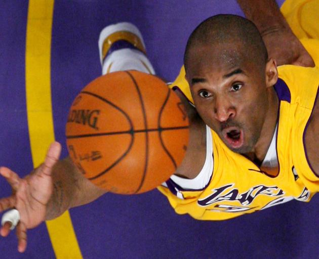 Los Angeles Lakers Bryant jumps for a rebound against the Denver Nuggets during NBA Western...