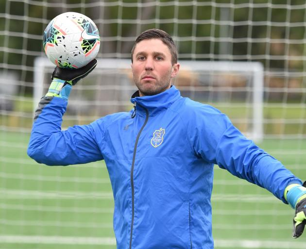 Southern United goal keeper Liam Little throws a ball at training on Thursday night. Photo: Gregor Richardson