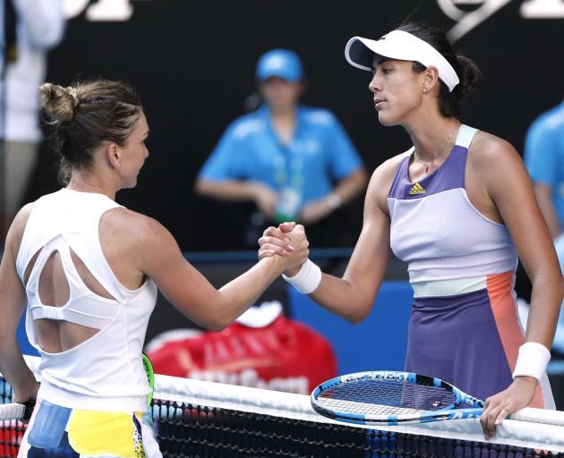 Spain's Garbine Muguruza and Romania's Simona Halep shake hands after their match. Photo: Reuters