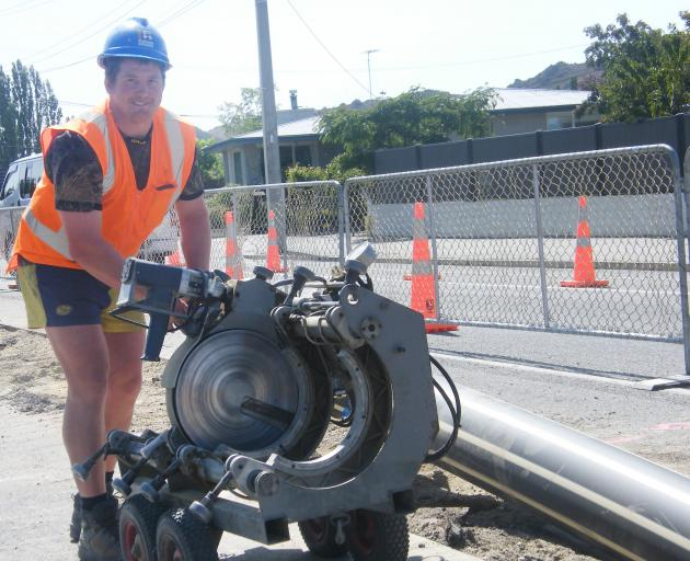 Central Otago District Council contractor Michael Harvey is all smiles yesterday as work on the Clyde wastewater pipeline in Tarbert St nears completion. Photo: Adam Burns