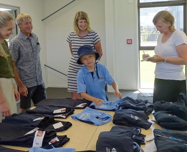 One of the first pupils at Te Kura O Take Karara to buy his new school uniform was Jack Jones (7)...