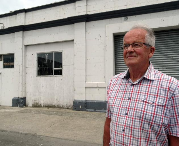 Former Oamaru borough councillor and deputy mayor Dr Ron Sim, outside a Coquet St building and...