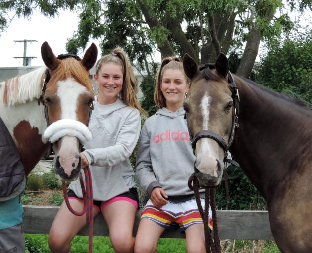 Samantha Gillies (left) with Junior Disco and Emma Gillies with Benrose Playtime relax at home on the farm. Photo: Sally Brooker