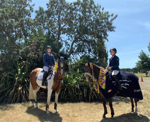 Samantha Gillies (left) on Junior Disco and Emma Gillies on Benrose Playtime display the ribbons, garland and cover they won in Christchurch. Photo: Supplied