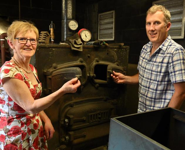 Opoho School principal Jenny Clarke and board of trustees chairman Rob Fagerlund with the school's old coal boiler, which will be replaced with a biomass boiler. Photo: Linda Robertson