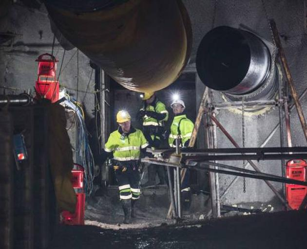 Pike River Mine recovery team members break through the concrete seal at the drift in May last...