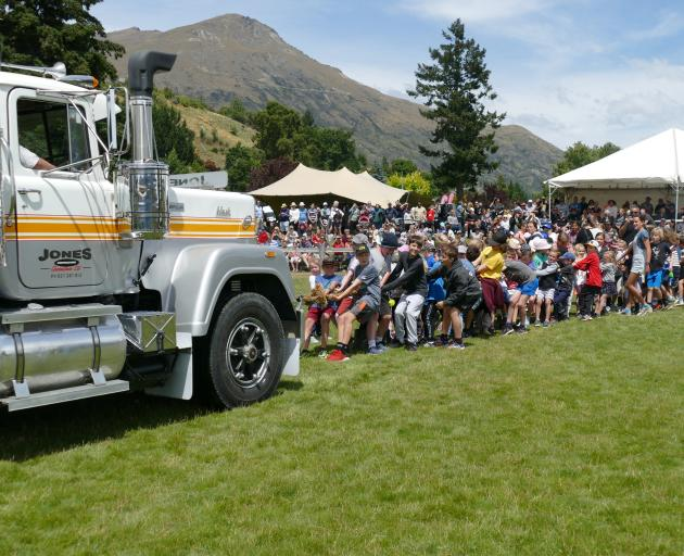 A group of children pull a 400hp Jones Contracting truck — left in neutral — at Saturday's Lake...