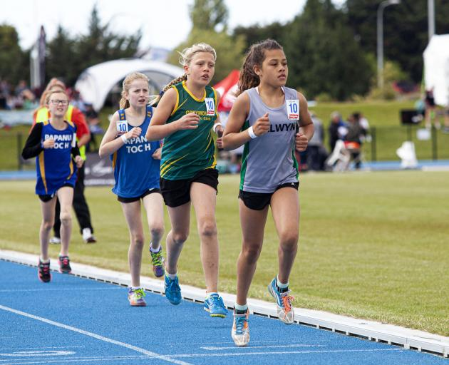 Saskia Kalotapu, 10, of the Selwyn Athletics Club, leads a group through the first lap of the...