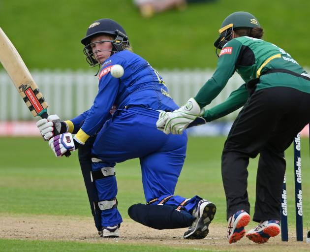 Sparks top scorer Millie Cowan flicks the ball past Hinds wicketkeeper Natalie Dodd during their...