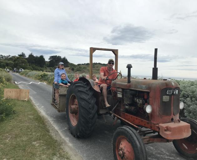 East Otago farmer Will Heckler shuttles precious cargo back to the holiday house after a day at the beach. On the back are his wife, Laura, with Ria Heckler (5), Taj Morey (8), Lucia Morey (9) and Luke Heckler (6). Photo: Alice Scott