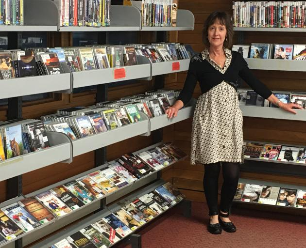 Dunedin Public Libraries DVD, Blu-ray, and CD collection manager Glenda Rogers has thousands of items available for hire. PHOTO: SUPPLIED