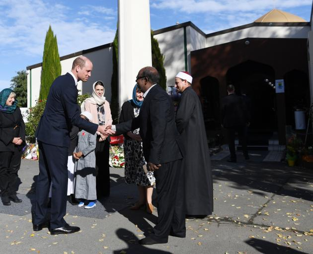 Prince William greets members of the Muslim community at Masjid Al Noor. Photo: Tracey Nearmy...