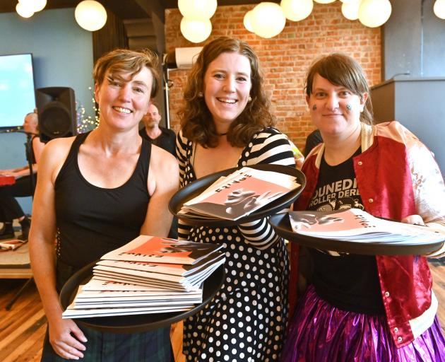 Roller derby competitors (from left) Annette King, Shanna Verhoef and Ella Strong distribute pamphlets at the launch of the 2020 Fringe Festival in Dunedin last night. Photo: Linda Robertson