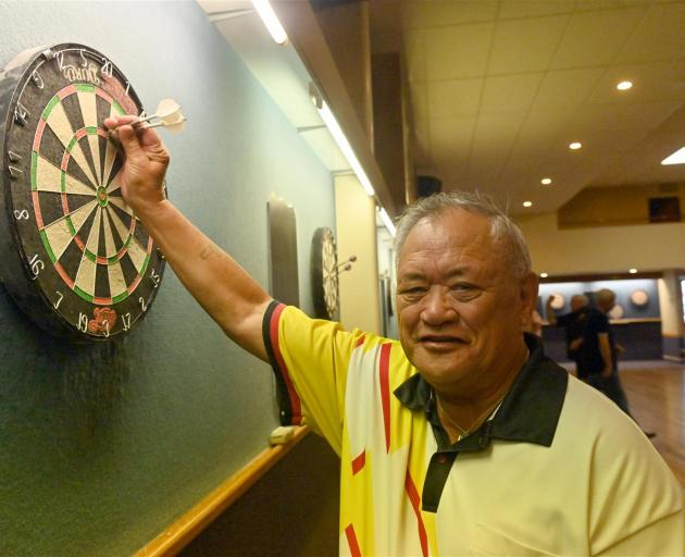 Ron Te Moananui, of Dunedin, checks his shot at the darts competition at the South Dunedin Town Hall yesterday.