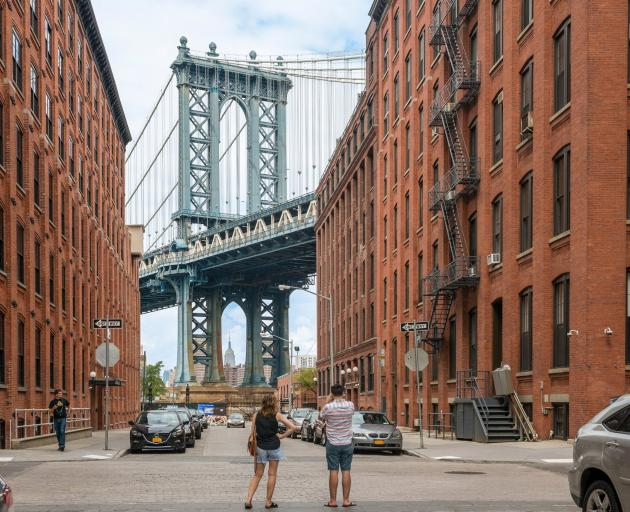 The famous view from Dumbo, Brooklyn, of the Manhattan Bridge and the Empire State Building....