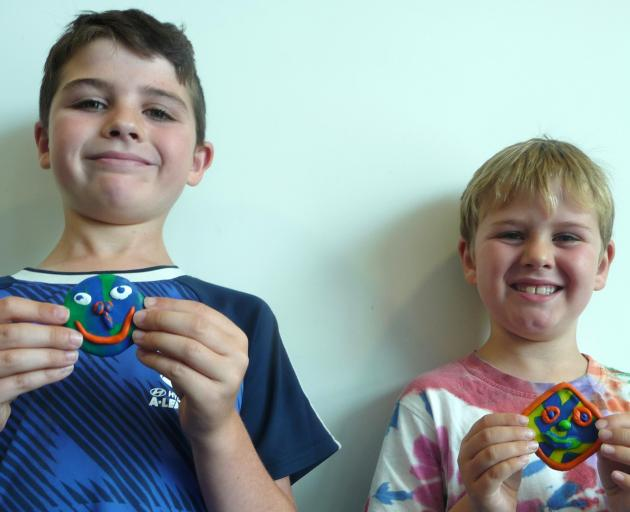 Enjoying the mirror art session were (from left) brothers Toby and Cohen Greer from Halswell, who...