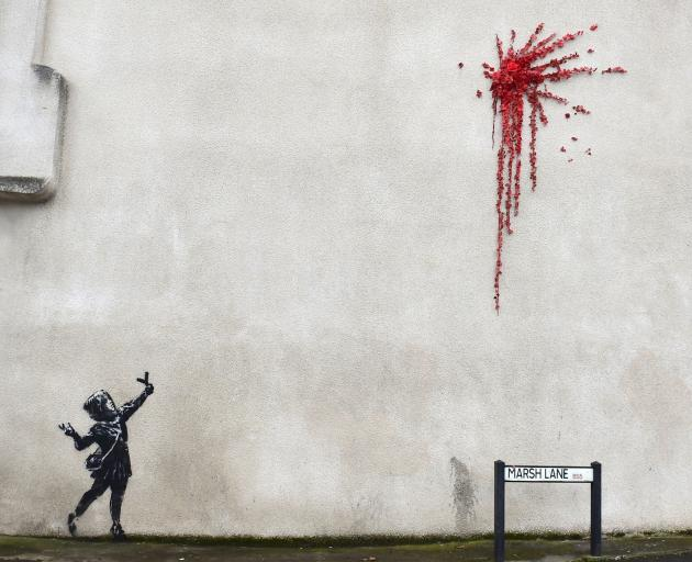 Banksy plays with violence and innocence in Valentine's Day graffiti