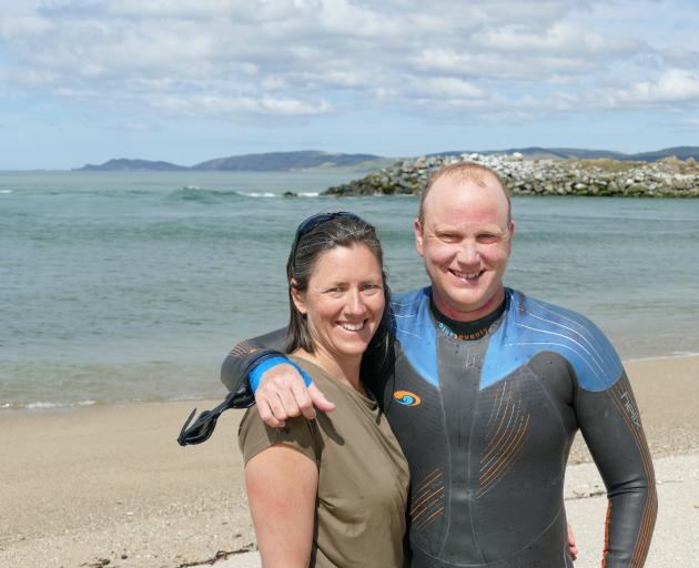 Clutha River swimmer Rob Hutchings and wife and support manager Tansy Boggan, of Christchurch, celebrate his 239km swim from Wanaka at the river mouth near Balclutha yesterday. Photo: Richard Davison