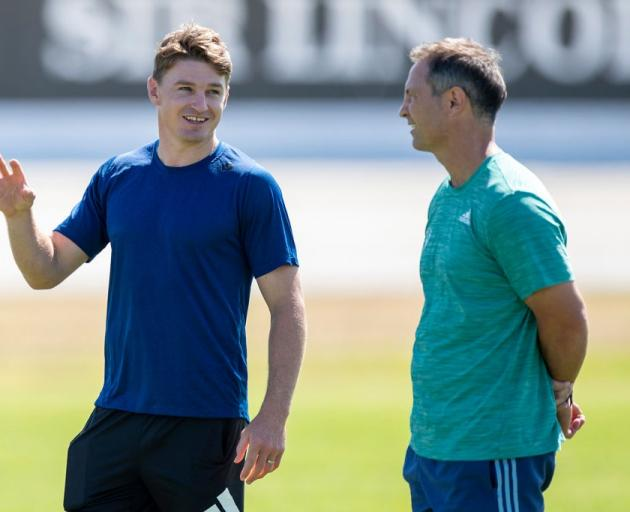 Beauden Barrett (left) talks with Blues coach Leon MacDonald. Photo: Getty Images