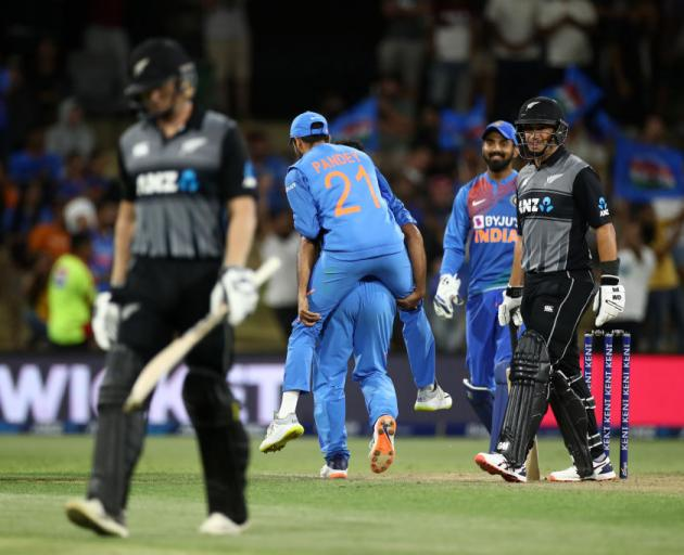 Ross Taylor watches on as another partner walks off the pitch after getting out. Photo: Getty Images