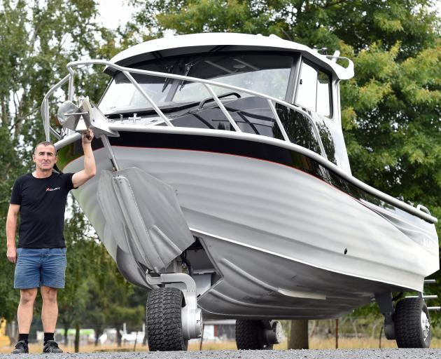 Steve McLay stands next to the Raptor 741 with its wheel and wheel door out and open. PHOTO:...