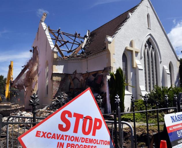 St James Church in South Dunedin was demolished yesterday because it was not earthquake-proof. Photo: Stephen Jaquiery