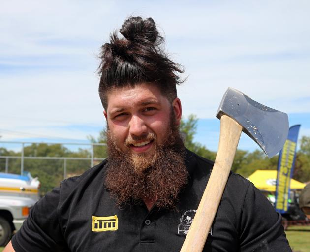 Twenty-three-year-old Brad Pako with his trusty axe at the Central Otago A&P Show on Saturday. PHOTO: SUPPLIED/ HARLEY PHOTOGRAPHY