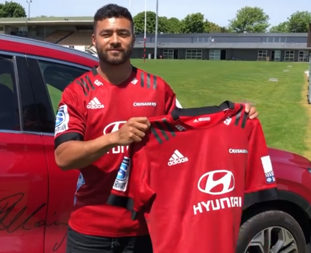 Richard Mo'unga shows off the new Crusaders home jersey for the 2020 season. Photo: Crusaders