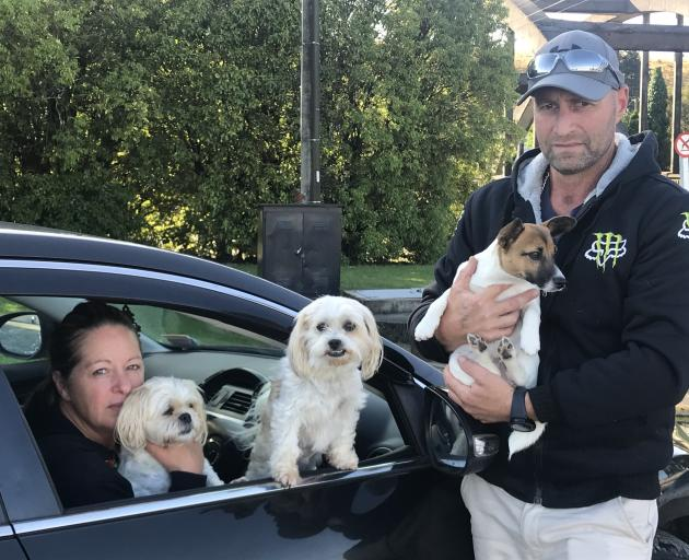Veronica and Corey Woodrow with their three dogs Pocket, Pixie and Mocha. Photo: Luisa Girao