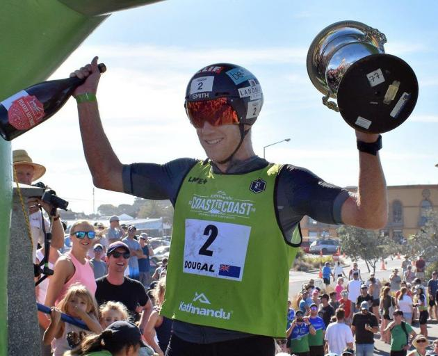 Dougal Allan with the victory spoils after winning last year's Coast to Coast.