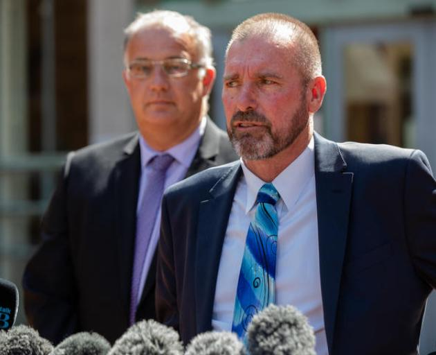 Detective Inspector Scott Beard, right, speaks to media outside the High Court at Auckland after...