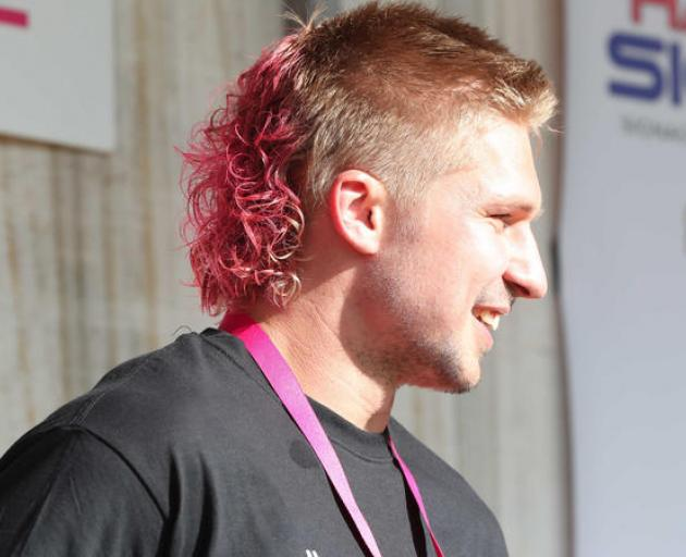 Jack Goodhue got to keep his mullet, but made over with pink dye and a perm. Photo: Northern...