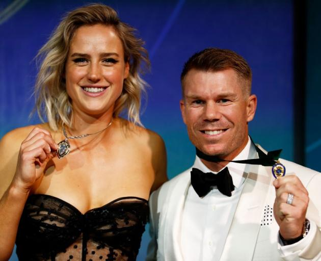 Ellyse Perry (left) and David Warner claimed the top prizes at the Cricket Australia awards last...