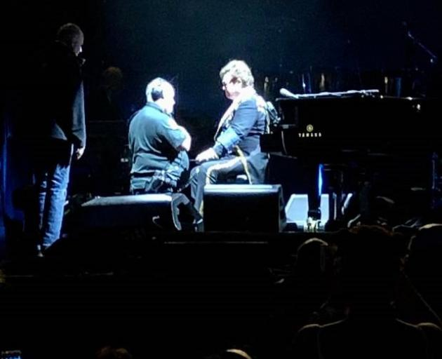 A medic appeared to take Elton John's blood pressure on stage as the singer battled to continue...