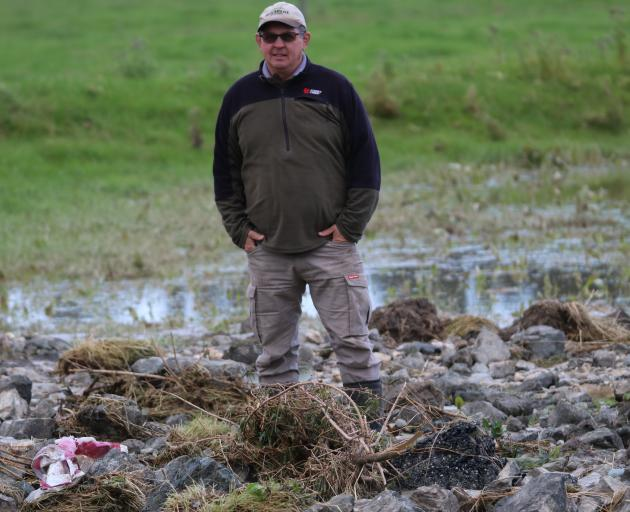 The cleanup continues for residents in the South affected by last week's flooding. Some, like Wendon farmer Murray Shallard, reckon it was probably the worst seen since the 1980s. Photo: Sandy Eggleston