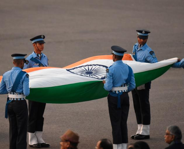Officers with an Indian flag during the Beating Retreat ceremony in New Delhi as part of Republic...