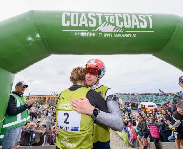 Dougal Allen (right) congratulates winner Sam Clark at the finish line. Photo: Getty Images