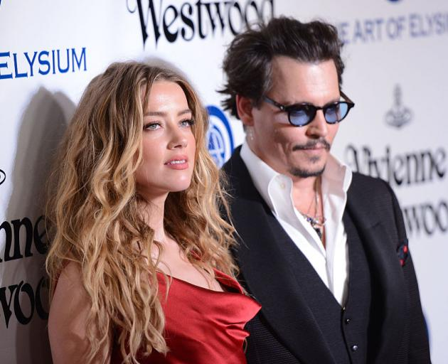 Amber Heard with Johnny Depp in 2016. Photo: Getty Images