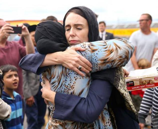 Jacinda Ardern consoles a woman at the Kilbirnie Mosque in Wellington on March 17. Photo: via NZ...